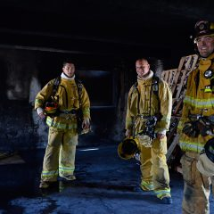 Two students and an instructor at the El Camino Fire Academy in Inglewood prepare a building for a live fire exercise. Photo by Nicole Mooradian.