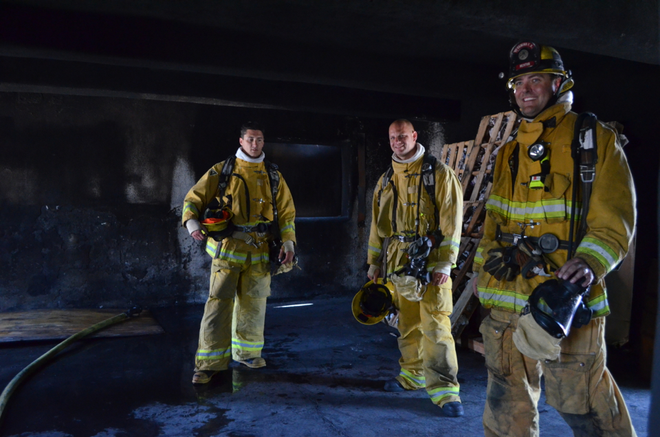 Two students and an instructor at the El Camino Fire Academy in Inglewood, Calif., prepare a building for a live-fire exercise. Photo credit Nicole Mooradian.