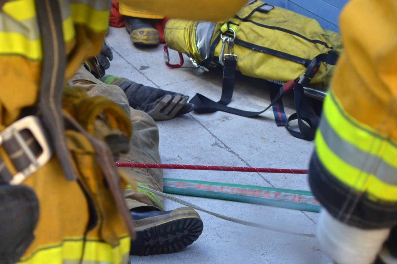 A firefighter pretends to be injured during a drill designed to allow Rapid Intervention Crews to practice rescuing other firefighters. Photo by Nicole Mooradian.
