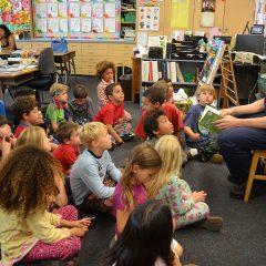 Firefighter-paramedic Darren Mallabon reads to students at Madison Elementary School. Photo credit Nicole Mooradian / Redondo Beach Patch.