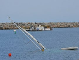 A sunken sailboat in King Harbor posed a hazard to vessels. Photo credit Nicole Mooradian.