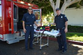 Paramedics from the Redondo Beach Fire Department show off a new CPAP unit. Photo credit Nicole Mooradian.